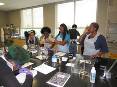 Lab group practicing safety protocol during a lab experiment