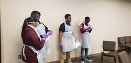 Students recording notes regarding crime scene