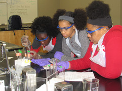 Students focused on a NIST experiment