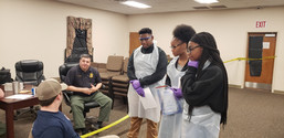 Students discuss evidence with Milledgeville Police Dept.