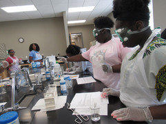 Students hard at work on an experiment with NIST