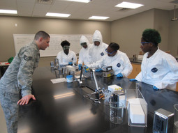 AFTAC assisting students in a radioactive search