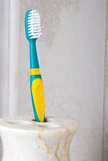 Toothbrush in a marble beige color holde