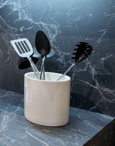 Marble effect kitchen counter with utens
