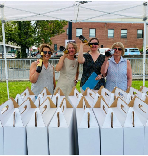 SOTA Volunteers having fun distributing wine for Days of Wine and Rose!