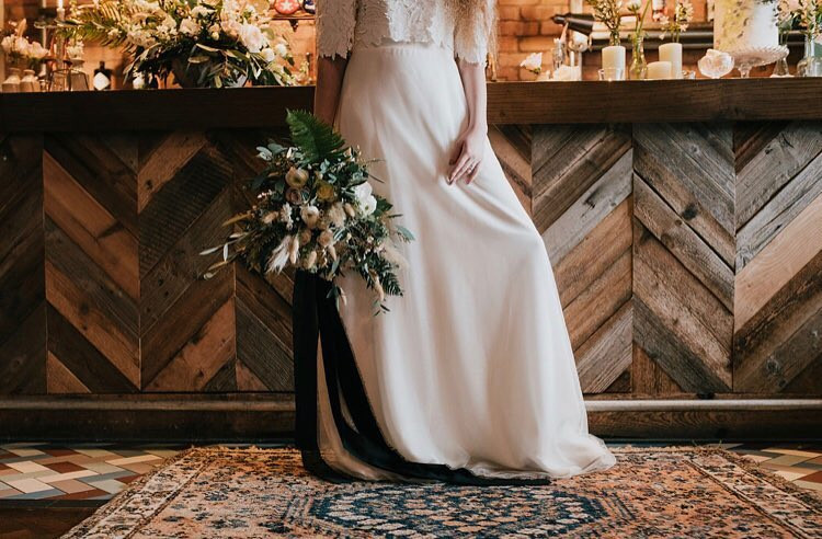 Boho wedding with antique rugs and wild bouquet