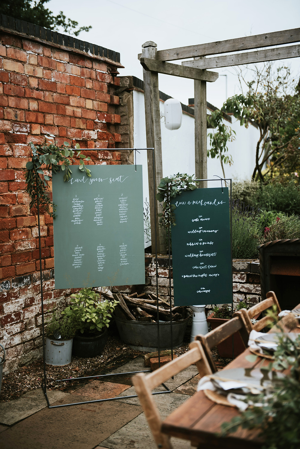 Bespoke two tone signage: Custom calligraphy seating plan and two in one welcome sign and order of the day. Image credit: Rosie Kelly Photography
