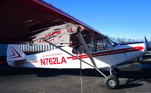 Here's all three Piper PA-18   Super Cubs on the dock   in Moose Pass.