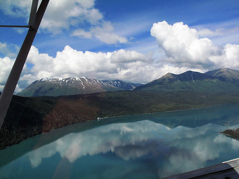 mountain flying with glassy water