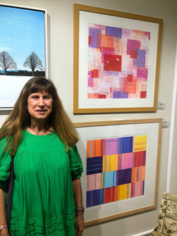 Christine Calow alongside her award winning vibrant Silkscreen artwork