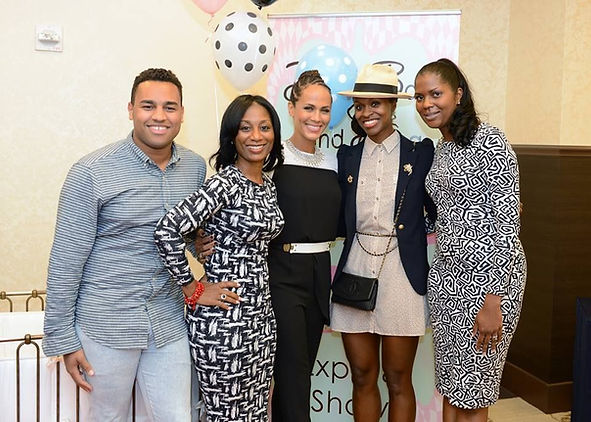 Maggy and Nicole Ari Parker Kodjoe  at special event