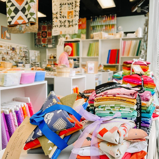 fat quarter bundles in a quilting and sewing store fabric store