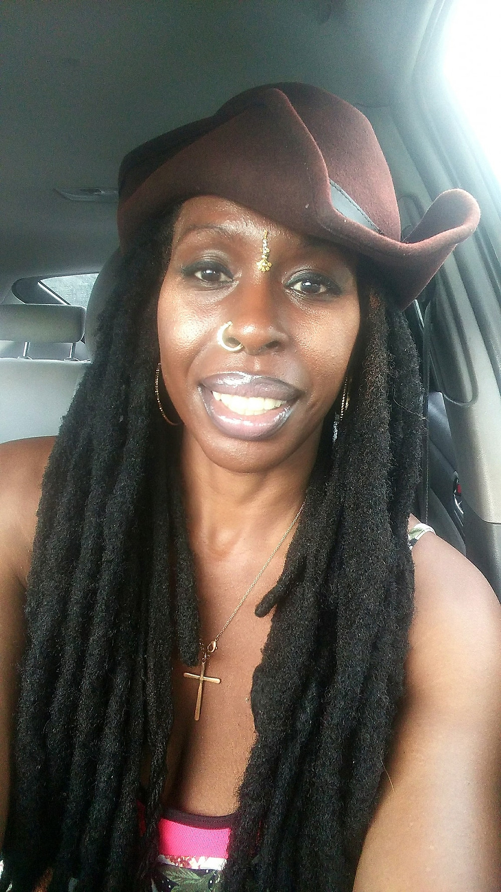 Dark skin women with locs