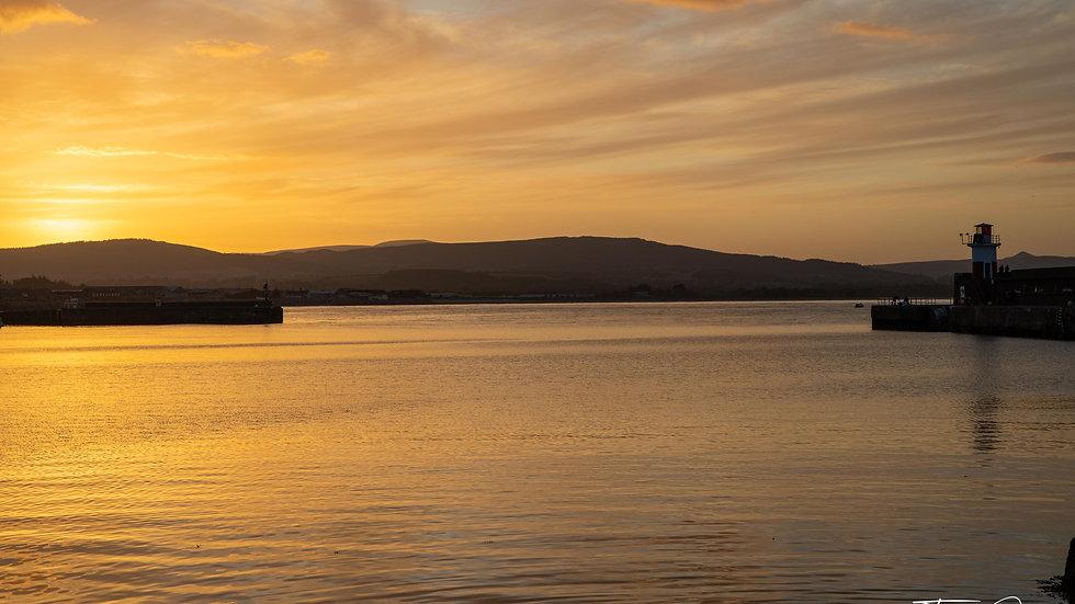 Golden sunset over the pier