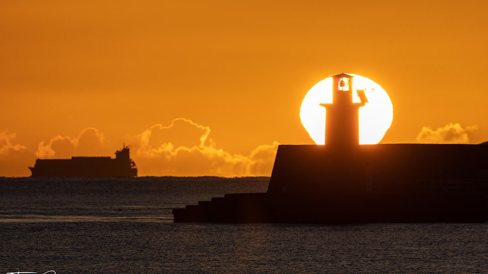 Sunrise behind Wicklow Lighthouse