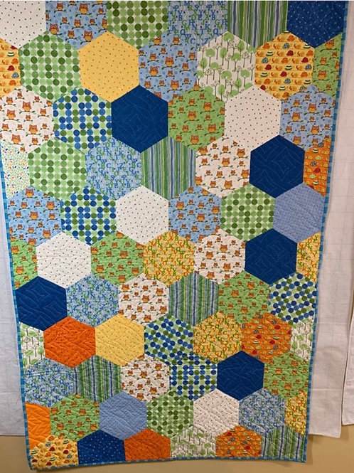 Hand pieced lap quilt