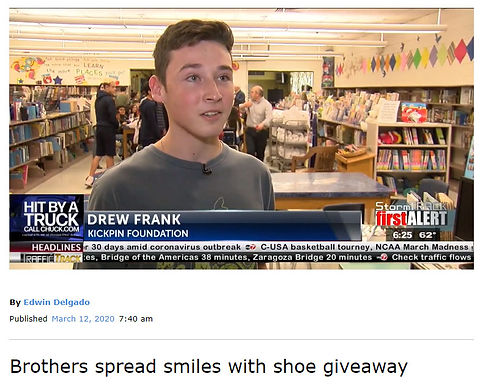 Brothers spread smiles with shoe giveaway