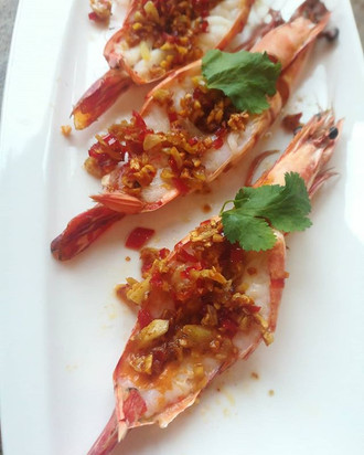 Grilled tiger prawns topped with crispy
