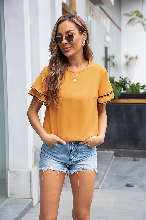 Yellow blouse with ruffled sleeve
