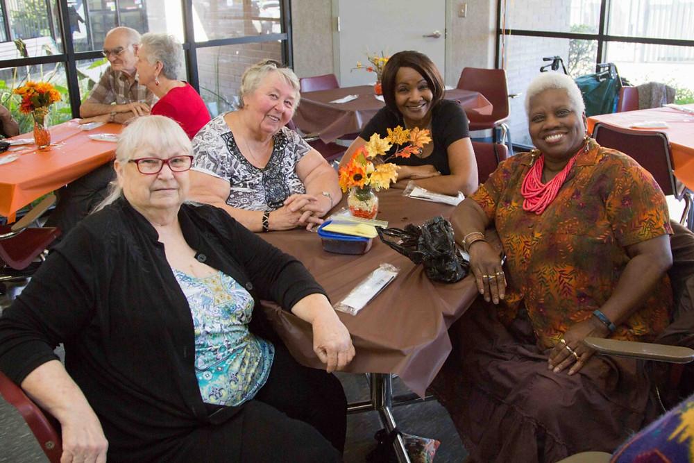 Activity Center Participants enjoy fellowship before the Thanksgiving feast