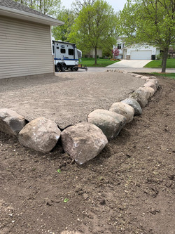 Parking Pad Lined W/Boulders
