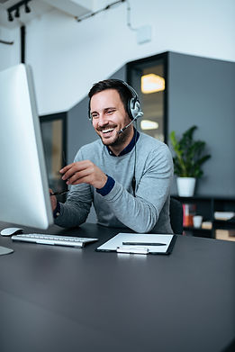 Casual smiling businessman with headset