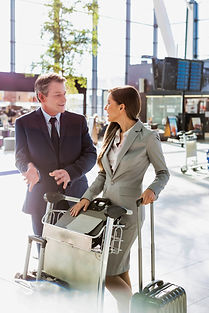 Business people talking while queueing f