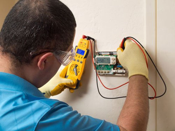 Electrician working on residential HVAC-500x375.jpg