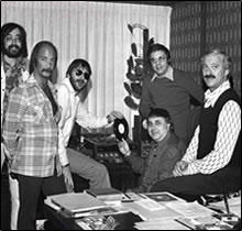 """L-R Jake Bloom, Herb Nanas, Denny Doherty (The Mamas and The Papas), Jeffrey Kruger (seated), John, Herb Eisman for Denny's single """"You'll Never Know"""" 1974"""