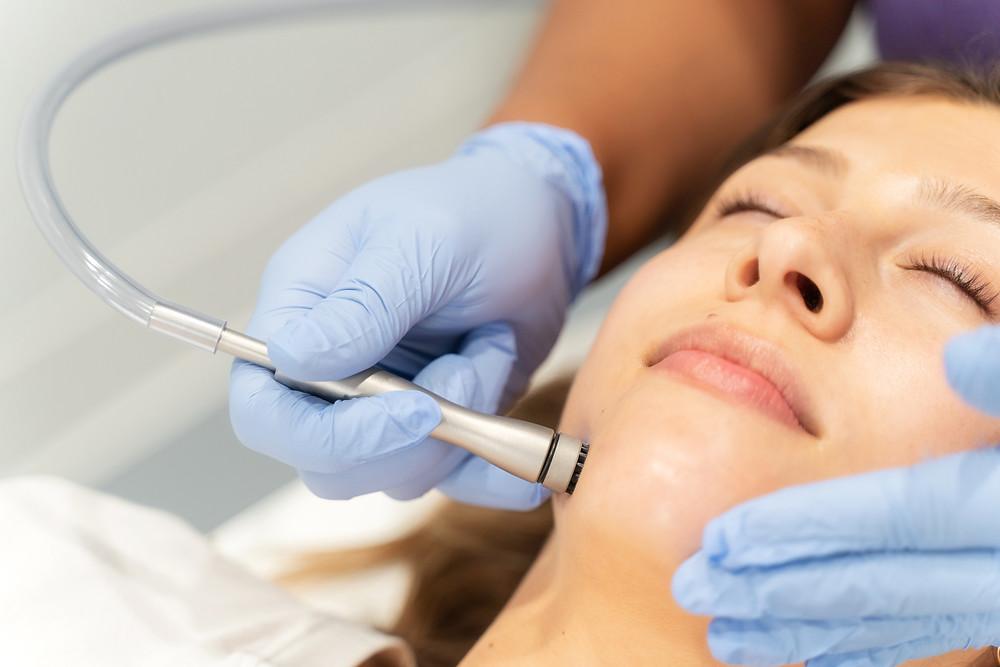 women getting a med tech facial