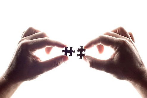 depositphotos_375199756-stock-photo-two-hands-trying-connect-puzzle_edited.jpg