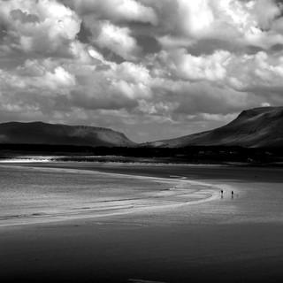 Walkers on an Irish beach B&W.jpg