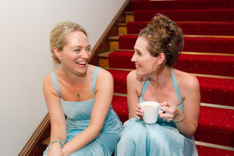 Bridesmaids wearing blue dresses