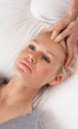 Woman having Shiatsu massage to head.jpg