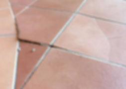 Buckled floor tilesno expansion lines
