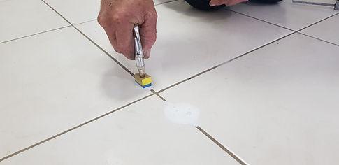 Tile Injection to repair floor tiles