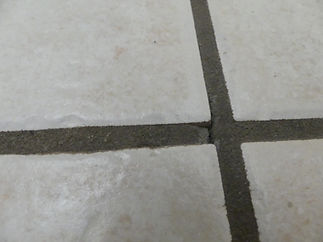 Cracked, loose and crumbly grout