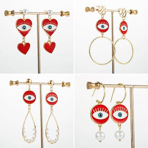 Boucles d'oreilles yeux/coeur