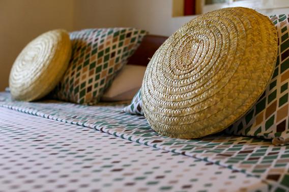 tayrona-pousada-detalhe-cama.jpg