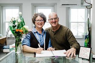 Irene & Charlie at front desk.jpg