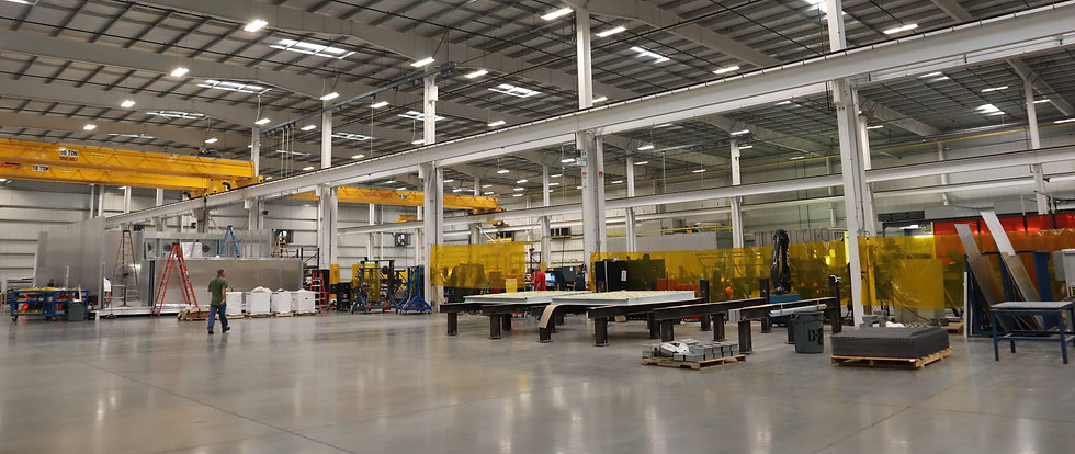 Lifts inside of metal manufacturing facility