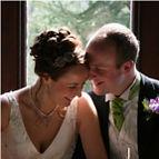 Janie and husband with custom wedding headband