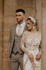 modern bridal jumpsuit with beaded satin headband