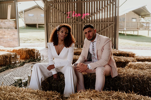 modern barn wedding with urban vibe, bridal jumpsuit and delicate wildflower pins by The Lucky Sixpence