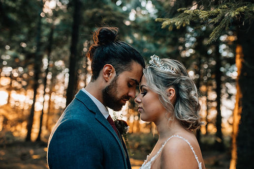 bride and groom in woodland eleopement. Bride wears a handmade leaf crown by The Lucky Sixpence