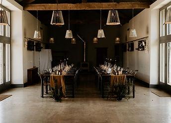 Urban vibe styled wedding breakfast tables in a rustic barn setting