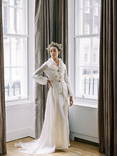 ruffled bridal coat with bell sleaves and statement headpiece