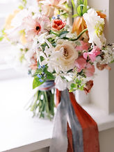 bridal wedding bouquet in pinks and oranges