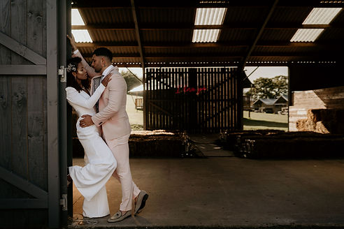 modern couple portrait at a rustic barn setting