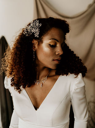 black bridal makeup and hair styling for modern barn wedding. Bride wears gypophila hair pins handmade by the lucky sixpence